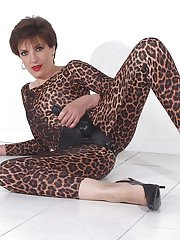 Tempting mature fetish lady posing in various leopard-print outfits