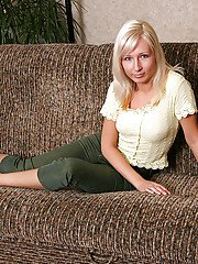 Fuckable blonde amateur stripping and posing naked on the couch