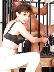 Naughty fetish ladies torturing their caged male pets swollen dick
