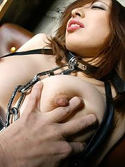 Asian fetish girl in collar and chain leash gets involved into sex play