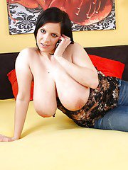 Chubby brunette in jeans revealing her huge flabby knockers