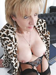 Mature fetish lady in leopard coat and stockings reveals her jugs
