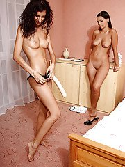 Sweetly pretty lesbian gets her shaved pussy hammered by a huge strapon