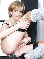 Sporty mature blonde with round jugs teasing her pink twat