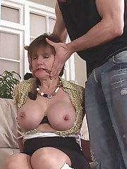 Submissive mature lady with round boobs enjoys hardcore BDSM action