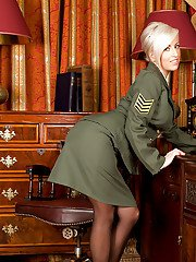 Steaming hot platinum-blonde lady in army uniform reveals her jugs and vag