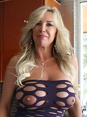 Full-chested blonde MILF in sexy dress pleasing her cunt with a vibrator