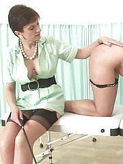 Submissive brunette has some spanking fun with her naughty femdom