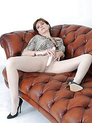 Horny mature bombshell in white pantyhose toying her bald slit