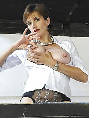Sassy fetish lady in stockings and white shirt revealing her big jugs