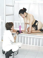 Busty mature femdom has some fun with her submissive asian male pet