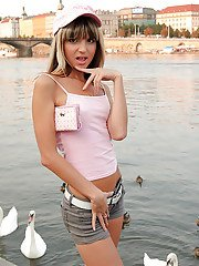 Skinny teen in shorts uncovering her tiny tits in a public place