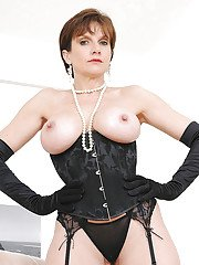 Mature femdom in high-heeled boots pleasing her masked male pets hard cock