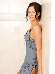 Svelte MILF taking shower in her lingerie and caressing herself