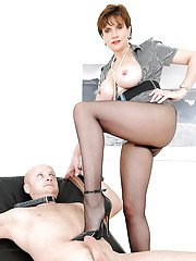 Barely clothed mature femdom in pantyhose teasing her male pets hard dick