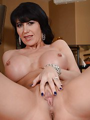 Voluptuous MILF Eva Karera stripping and spreading her pussy lips