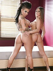 Desirable vixens with big round tits stripping and caressing each other