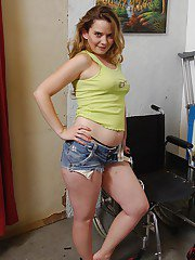 Lewd MILF in jeans shorts Tera Knightly getting naked and spreading her legs
