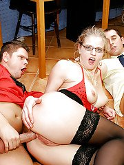 Lustful blonde in glasses enjoys a groupsex and takes a triple facial