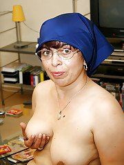 Fatty granny with flabby tits and ample ass getting naked