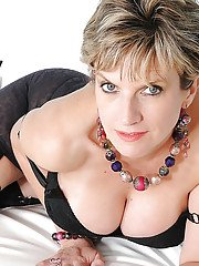 Shapely mature fetish lady posing in black stockings and lingerie