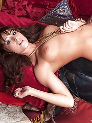 Adorable babe Leia Christiana slipping off her snazzy lingerie
