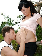 Pregnant brunette with big tits enjoys sensual twatting outdoor