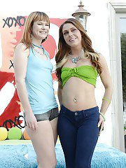 Foxy babes Claire Robbins  Scarlett Wild posing and stripping together