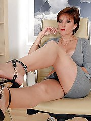 Mature fetish lady spreading her long legs and exposing her black panties