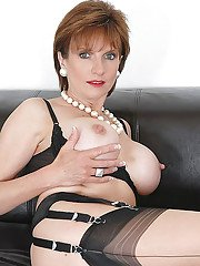 Busty mature fetish lady in lingerie and stockings caressing herself
