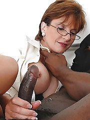 Kinky mature lady has some fetish fun with a well-hung masked black lad