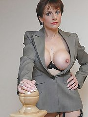 Mature fetish lady with big jugs posing in stockings and formal jacket