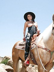 Busty latina vixen Charley Chase posing outdoor in snazzy cowgirl outfit
