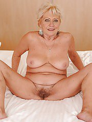Smiley blonde granny getting naked and exposing her hairy cunt