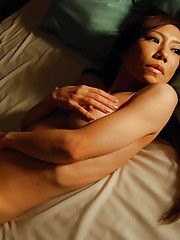 Asian MILF Mika Fukuyama stripping down and spreading her legs