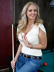 Stupendous MILF Julia Ann getting naked on the pool table