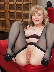 Mature vixen Nina Hartley gets rid of her dress and spreading her legs