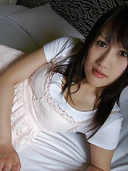 Frisky asian lady Keiko Okuyama stripping and spreading her lower lips