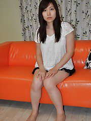 Cute asian teen Satsuki Okuno undressing and playing with a vibrator
