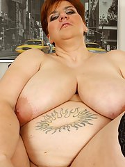 Mature SSBBW star with huge melons toying her shaved twat