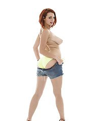 Foxy redhead in daisy duck shorts uncovering her tempting curves