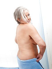 Fatty granny with massive saggy tits playing with herself after bath