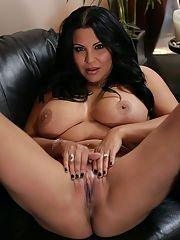 Top-heavy latina MILF in high-heeled boots undressing and spreading her legs