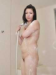Asian MILF Aya Uchiyama taking shower and teasing her cunt with water jets