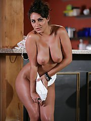 Naughty latina bartender undressing to expose her big bosoms and hot ass