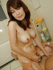 Asian MILF has some wet and dirty fun with a naughty lad in the bath