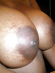 Curvaceous ebony lassie Serenity Red undressing and picturing herself
