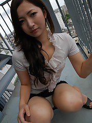 Asian teen Yuma Yoneyama undressing and spreading her lower lips in close up