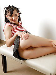 Naughty babe with no panties under her greyhound exposing her gash