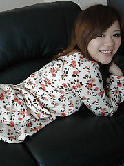 Smiley asian teen Reina Fukumoto undressing and posing nude on the bed